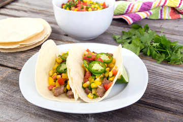 beef corn soft taco on rustic wood table