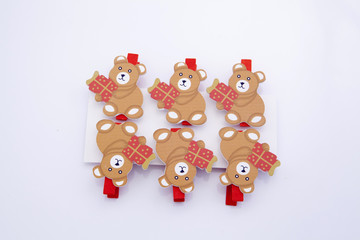 Decorative clothespins for christmas -teddy bear holding gift