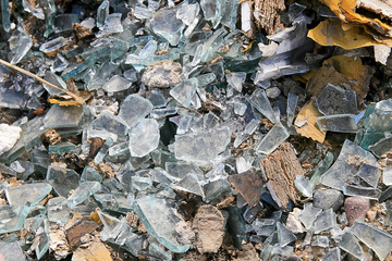 Pieces of glass, a lot of broken glass in the dump. Pollution.