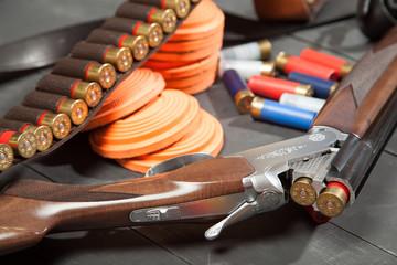 Sport shooting equipment on target. Air-gun and bullets.