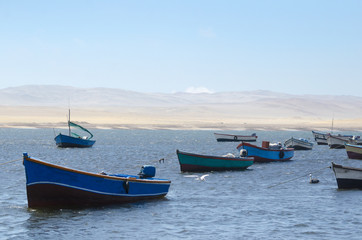 View to the fisherman boats, sea and desert