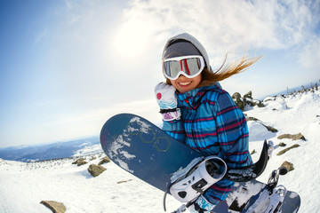 In de dag Wintersporten Girl snowboarder enjoys the ski resort