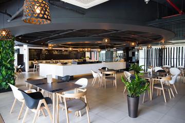 Hotel cafe interior with menu on blackboard