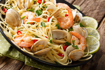 Italian pasta with clams and shrimps close-up. Horizontal