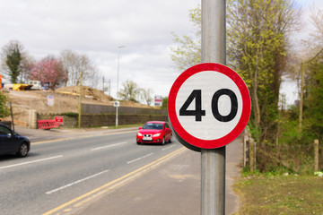British 40 Mile per hour restricted traffic zone with defocussed vehicles