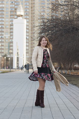 The cheerful woman smiles in the park in Tyumen.