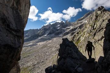 Hiker walking through Sentiero Roma at Qualido Pass, Valmasino.Valtellina Lombardy Italy Europe