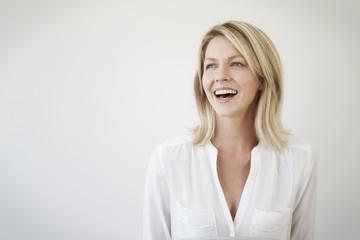Pretty woman in white, smiling