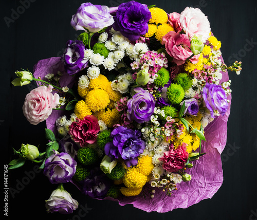 Bouquet with a lot of different flower on the wooden for A lot of different flowers make a bouquet