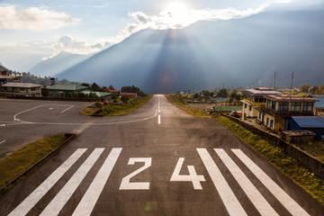 Runway of small Airport in Himalaya Mountains at Sunset