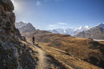 Hiker in the sunlight Languard Valley Engadine Canton of Grisons Switzerland Europe