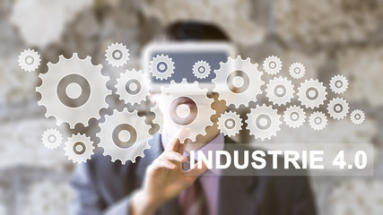 Businessman pressing button Industrie 4.0 gear, engineering virtual reality.