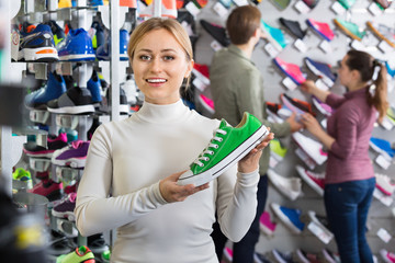 Girl promoting shoes in the sport boutique