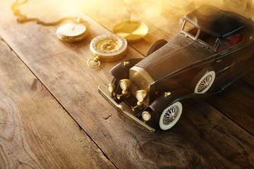 Vintage toy car over wooden table
