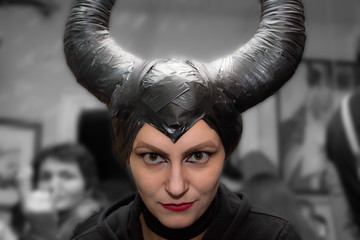 Novi Sad, Serbia - November 01, 2014: Maleficent  - beautiful woman from a fairytale with hair horns and creative make-up for the Halloween party.