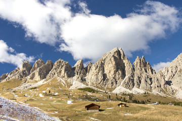 Blue sky and clouds on the high rocky peaks at Gardena Pass South Tyrol Trentino Alto Adige Italy Europe