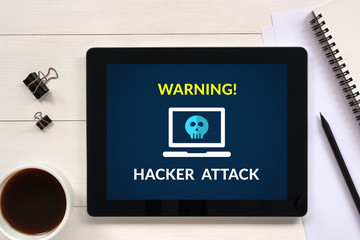 Hacker attack concept on tablet screen with office objects on white wooden table. All screen content is designed by me. Flat lay