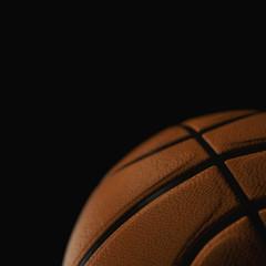 Basketball ball closeup on black background