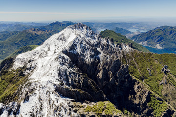Aerial view of the snowy ridges of Grignetta and Resegone with the lake in the background Lecco Province Lombardy Italy Europe