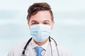Portrait of handsome male doctor with mask