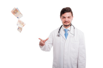 Rich male doctor drop bancknotes of euro