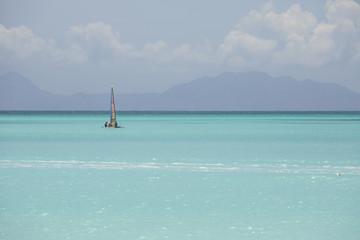 A catamaran in the crystalline waters of the Caribbean Sea Jolly Beach Antigua and Barbuda Leeward Island West Indies