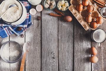 Baking ingredients on rustic wood background