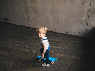 Little boy teaching skate on the skateboard