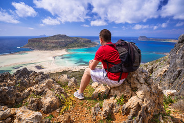 Man with backpack watching beautiful Balos beach on Crete, Greece