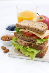 school lunch with sandwich of wholemeal bread, vertical