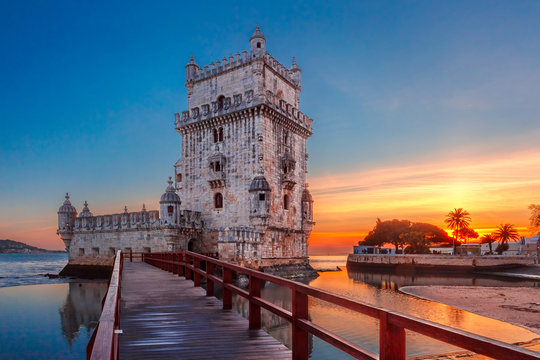 Belem Tower or Tower of St Vincent on the bank of the Tagus River at scenic sunset, Lisbon, Portugal