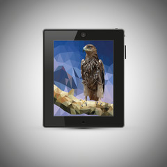 Tablet on grey background. Tablet on screen, bird on a branch.