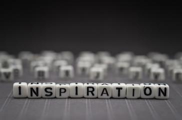 INSPIRATION, by alphabet beads with dark background