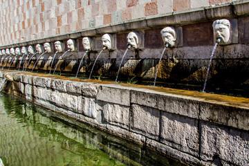 Fountain of the 99 Spouts ( Fontana delle 99 cannelle), L Aquila, Italy