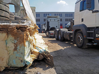 Truck trailer fragment (refrigerated) after an accident. Parking lot truckers