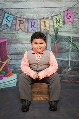 latino boy at easter in a suit