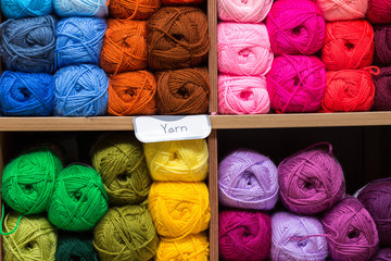 shelves with colorful yarn balls in store