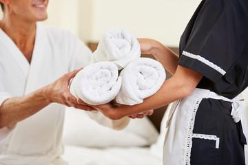 Maid bringing fresh towels