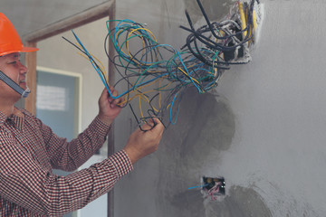 Electricians clears the ends of the wires. installation works