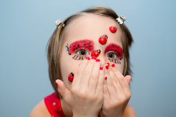 Little girl with ladybug face paint