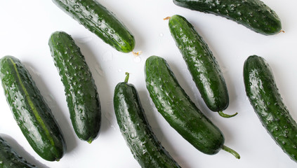 Fresh cucumbers on white wooden table