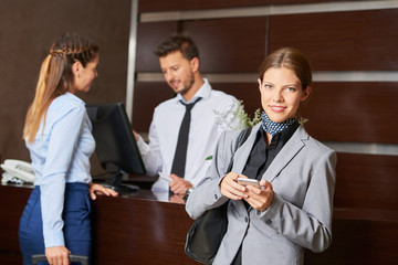 Businesswoman at check-in in hotel