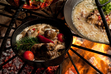 cook a meat dish with spruce branches at the stake