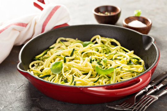 Spiralized zucchini noodles in a cast iron pan