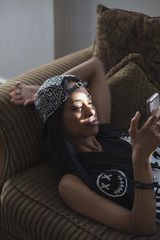 Beautiful young womon lying on couch
