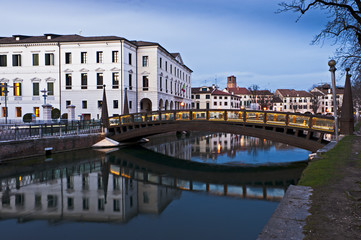 The University Bridge reflects on river Sile in Treviso. Italy