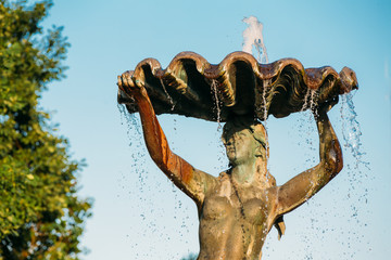 Riga, Latvia. Fountain Nymph In Water Splashes In Aspazijas Boulevard