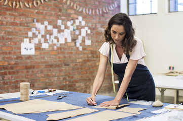 Fashion designer working at table in workshop