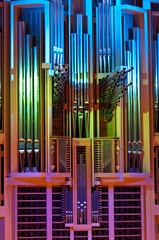 Shining pipes of organ illuminated with multicolor light