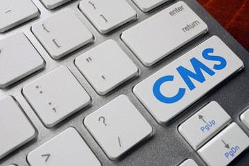 CMS Content Management System on a keyboard button.